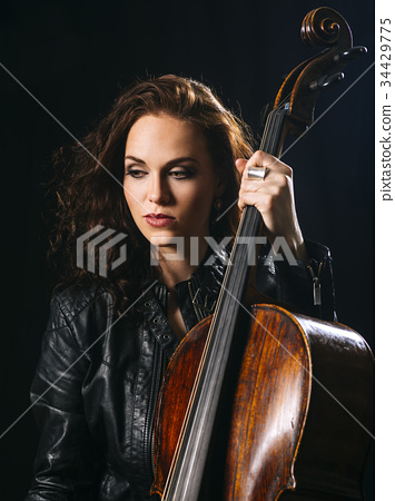 Beautiful cellist holding her cello 34429775