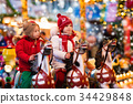 Children riding carousel on Christmas market 34429848