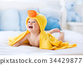 Cute baby after bath in yellow duck towel 34429877