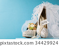 Beautiful arrangement of shoes bridal accessories 34429924