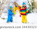 Kids building snowman. Children in snow Winter fun 34430323