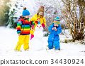 Kids building snowman. Children in snow Winter fun 34430924