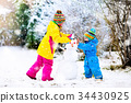 Kids building snowman. Children in snow Winter fun 34430925