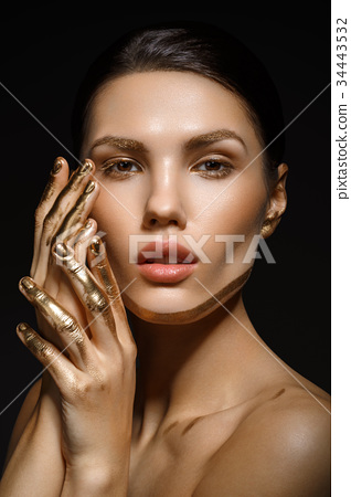 girl with golden paint on fingers 34443532
