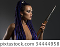 Horsewoman with dreadlocks topless profile view 34444958