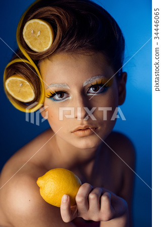 woman with fruit in hair 34446065