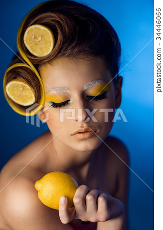 woman with fruit in hair 34446066