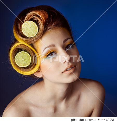 woman with fruit in hair 34446178