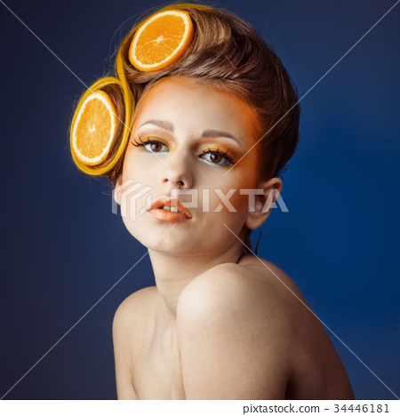 woman with fruit in hair 34446181
