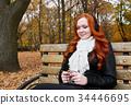 young woman portrait in autumn park  34446695