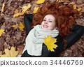 young woman portrait in autumn park  34446769