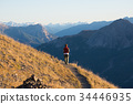 Hiker in high altitude rocky mountain landscape. 34446935
