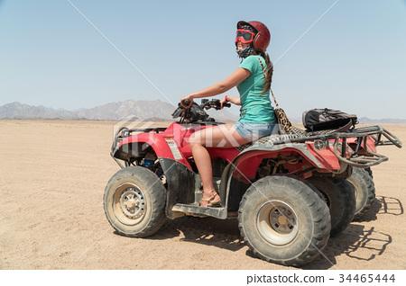 Adventurous woman on road trip through the Desert 34465444
