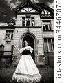 Mysterious woman in a white Victorian dress 34467076