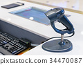 Cash desk with computer screen and barcode scanner 34470087