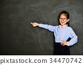 happy kid tutor using chalk pointing empty area 34470742