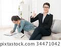 girl writing undersigned on insurance document 34471042