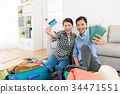 happy women looking at camera holding credit card 34471551