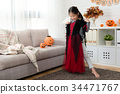 kids look at new Halloween witch dress 34471767