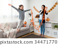 happy mother looks her cute girl play fly jump 34471770