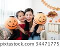 Happy family prepares for Halloween 34471775
