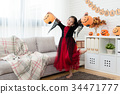 girl holding pumpkin lantern to dance 34471777