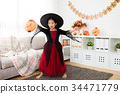 girl holding pumpkin lantern play alone 34471779