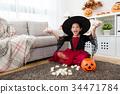 girl celebrate she own many sweet candies 34471784