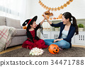 girl and her mother celebrate she obtain 34471788