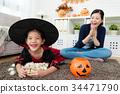 little kid girl holding her sweet marshmallow 34471790