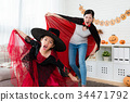 girl wearing witch dress with her mother wearing vampire cloak 34471792