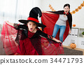 little girl and her mother try to scare people 34471793