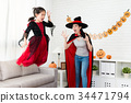 horror little witch girl jump from the sofa 34471794
