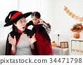 witch girl scared mother from the back have fun 34471798