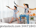 pirate costume girl and her mother play game 34471843