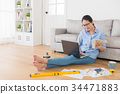 attractive designer lady using mobile computer 34471883