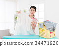smiling attractive woman holding white shirt 34471920