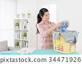 beautiful young lady doing housekeeping at home 34471926