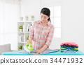 sweet pretty housekeeper ironing family clothing 34471932