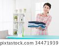 beautiful housework woman ironing all clothing 34471939