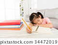 young kid girl student leaning on living room desk 34472019
