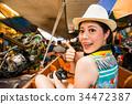 happy female tourist at Damnoen Saduak of Thailand 34472387