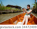 beautiful young traveler woman taking on boat 34472409