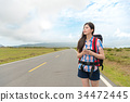 attractive female hiker holding mobile smartphone 34472445