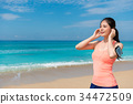 smiling pretty woman running workout on beach 34472509