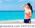 pretty elegant fitness woman standing on beach 34472536