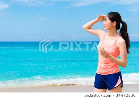 pretty elegant fitness woman standing on beach 34472536