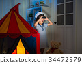 little girl playing as sailor in living room 34472579