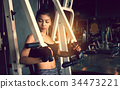 Asian sporty woman exercise gym club. 34473221