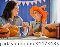 family preparing for Halloween. 34473485